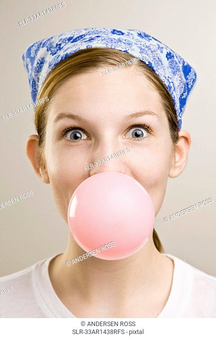 Woman blowing a bubble with gum