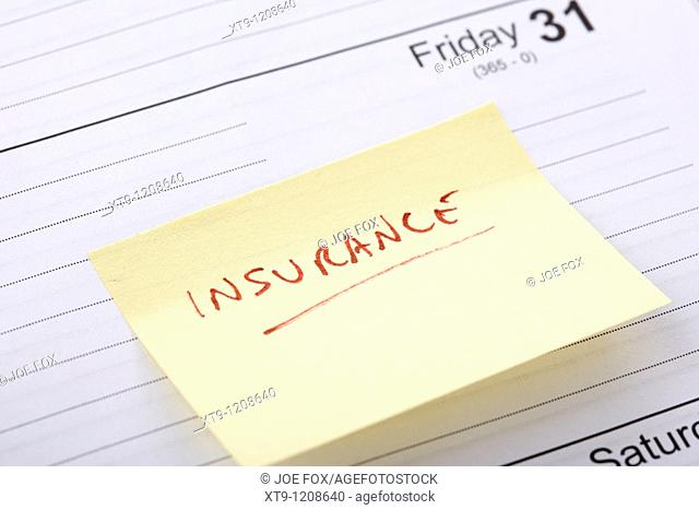 post-it note regarding insurance bill due stuck into a diary at the end of the month