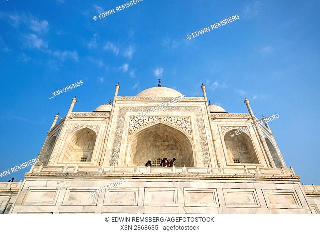 Tourists looking out onto the Taj Mahal complex from above, in Agra, India