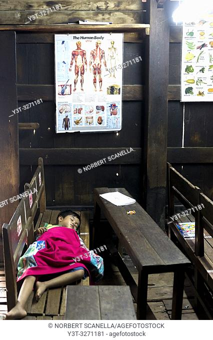 Myanmar (ex Birmanie). Inwa region of Mandalay. Bagayar monastery. Monastic school. Sleeping Child
