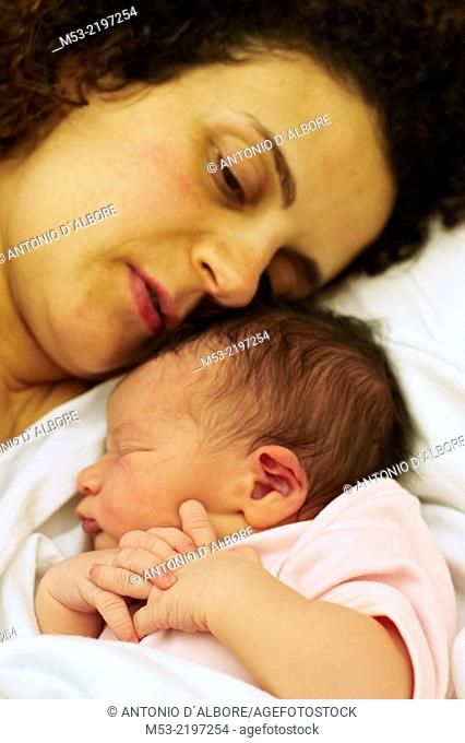 A caucasian mother with her newborn baby girl