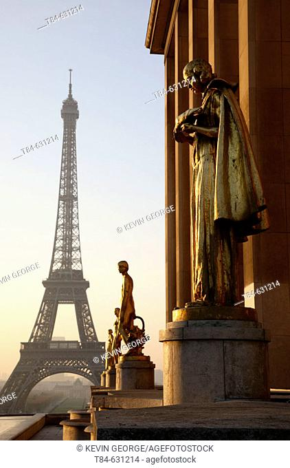 Golden statues of the Palais of Chaillot and the Eiffel Tower. Paris. France