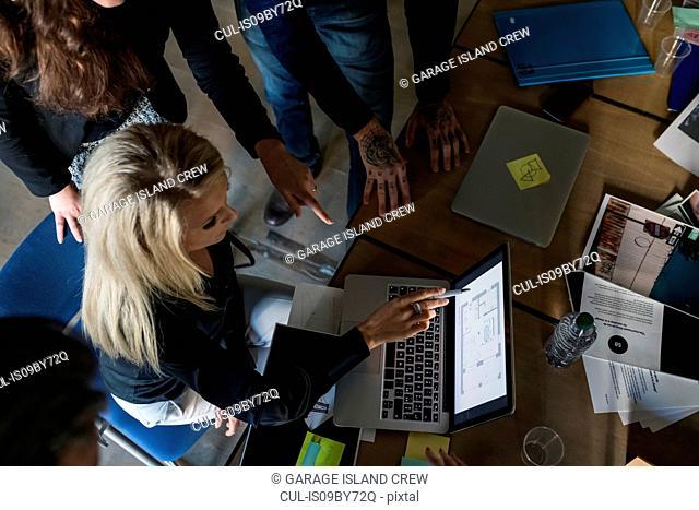Businessmen and businesswomen having brainstorming meeting in office