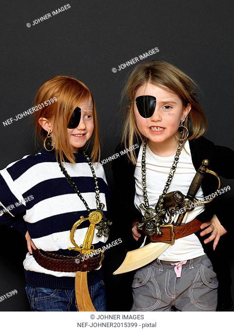 Girls dressed up as pirates, studio shot