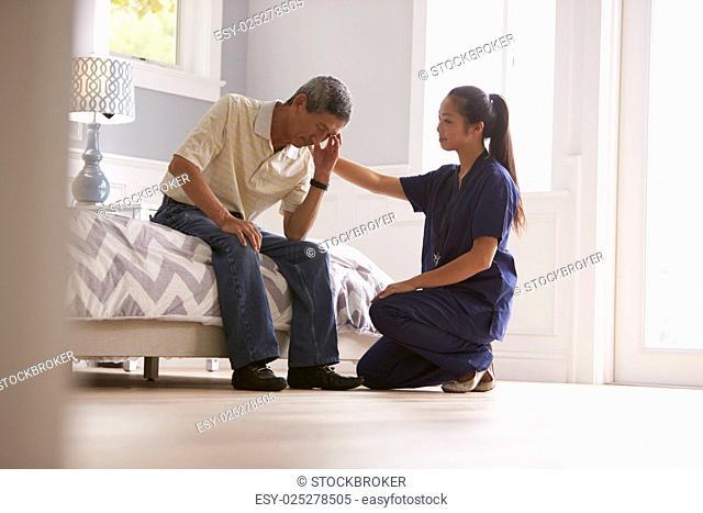 Nurse Making Home Visit To Depressed Senior Man