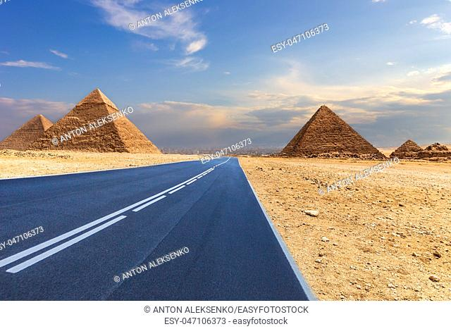 Giza Pyramids and a road in the desert, Egypt, no people