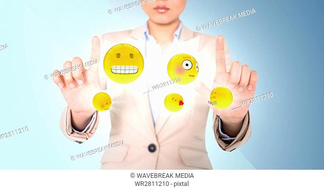 Business woman with emojis and flares between hands against blue background