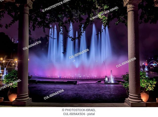 Blue and purple illuminated fountain at night, Park of the Reserve (Parque de la Reserva), Lima, Peru
