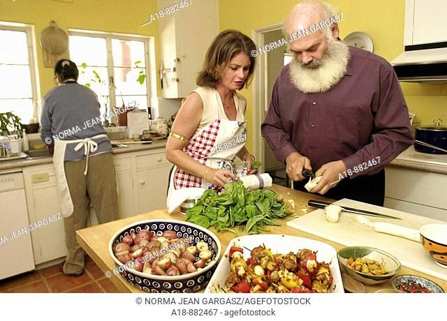 Alternative medicine advisor, Dr. Andrew Weil, right, and Rosie Daley, former personal chef for Oprah Winfrey, prepare a meal in Weil's home in Vail, Arizona