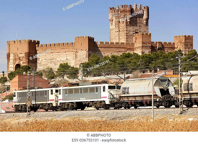 Freigh train with historic Medina del Campo's Castle landscape background