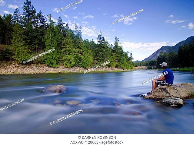 Man sits alongside the Similkameen River, near Hedley, British Columbia, Canada - self portrait