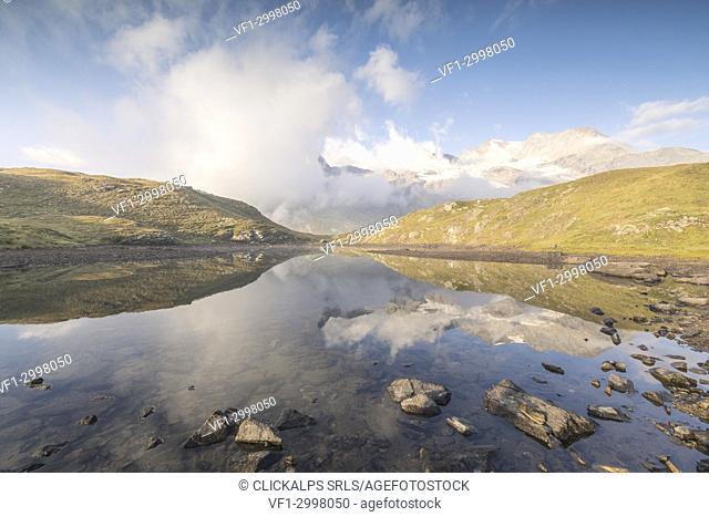 Clouds reflected in alpine lake, Bernina Pass, Poschiavo Valley, canton of Graubünden, Engadine, Switzerland