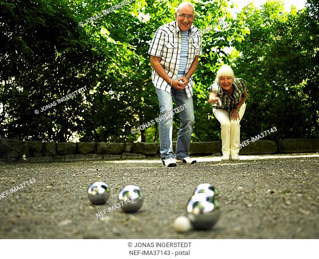 Senior citizen playing boule