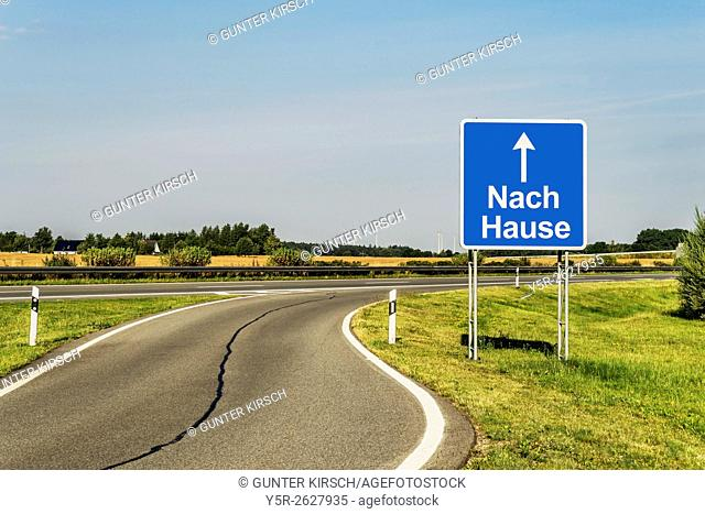 Road Sign with the German title Nach Hause (home) on the German Highway (Autobahn), Germany, Europe