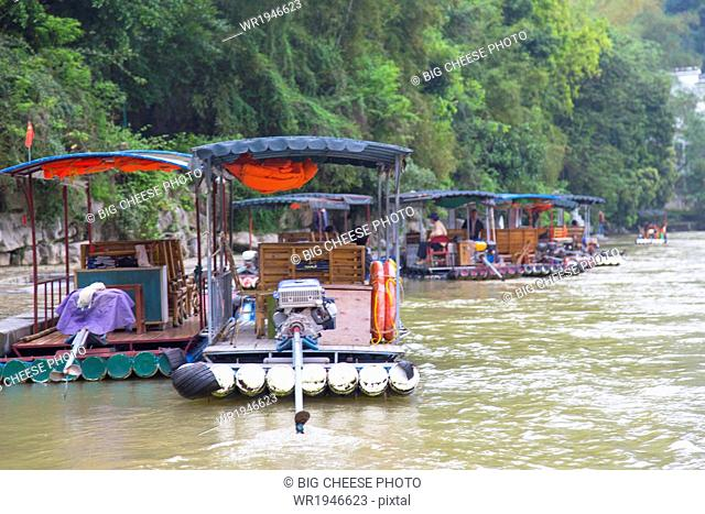 Tourists on bamboo rafts on the Li River, Yangshuo, China