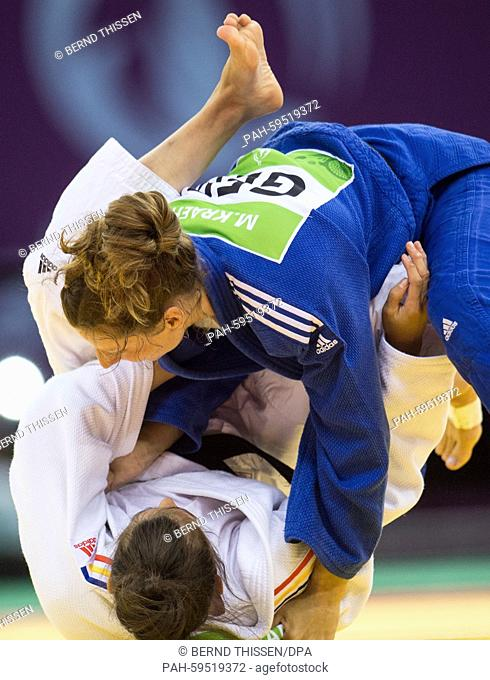 Germanys Mareen Kraeh (blue) competes with Larisa Florian of Romania in the Women's -52kg Judo Women's Bronze Final A at the Baku 2015 European Games in Heydar...