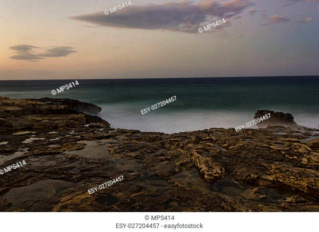 a view from Xaghra, Malta at sunset time