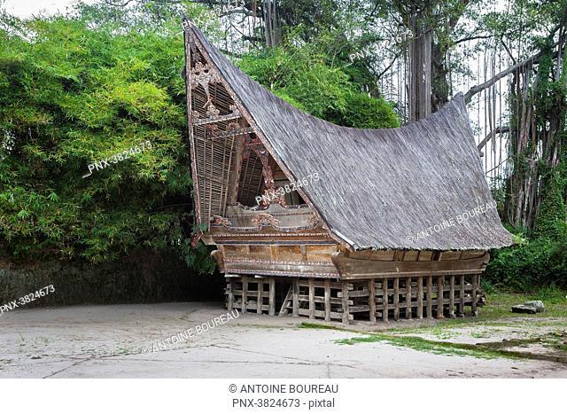 Traditional house Batak on the Tuk Tuk peninsula of Pulau island Samosir, Lake Toba, Sumatra, Indonesia