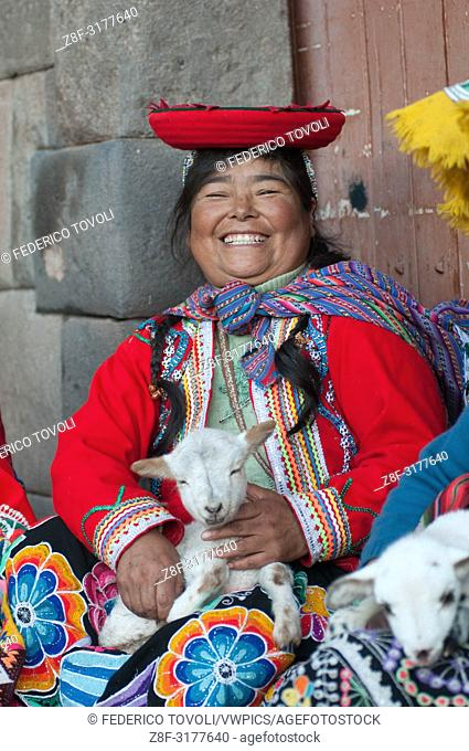 "They call them """"llamitas"""" because often bring with them a lama, but you can more easily see with a lamb in her arms. Dressed in their traditional clothes"