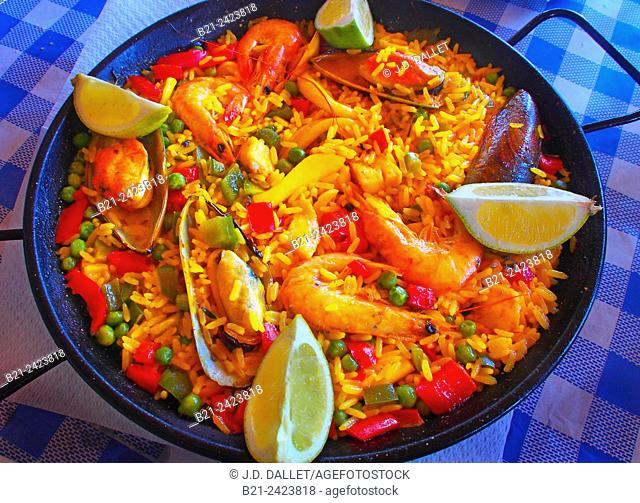Paella, Valencian rice dish with ancient roots that originated in its modern form in the mid-nineteenth century near Albufera lagoon