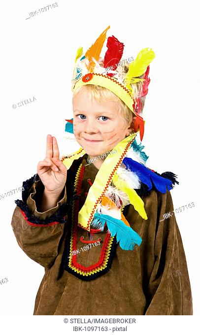 5-year-old boy dressed up as an American Indian, peace greeting