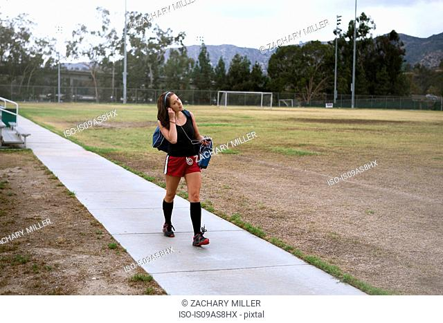 Soccer player using smartphone in field