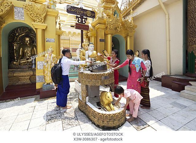 Devotees who make offers in a planetary point, Shwedagon pagoda, Yangon, Myanmar, Asia