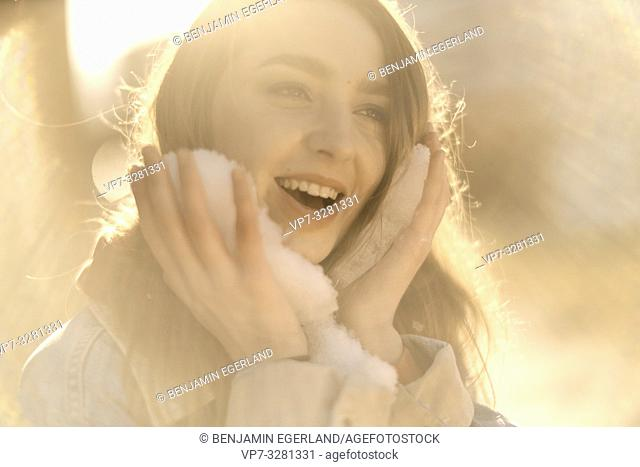 young woman with snow, winter season, in Cottbus, Brandenburg, Germany