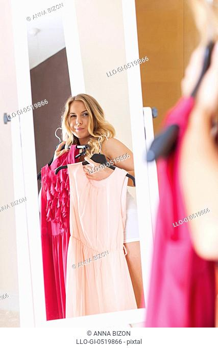 Blonde woman choosing dress for today. Debica, Poland
