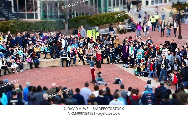 Street performer and audience in the Inner Harbor area of Baltimore, Maryland