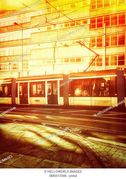 Tram at dawn, Nottingham, Nottinghamshire, East Midlands, England