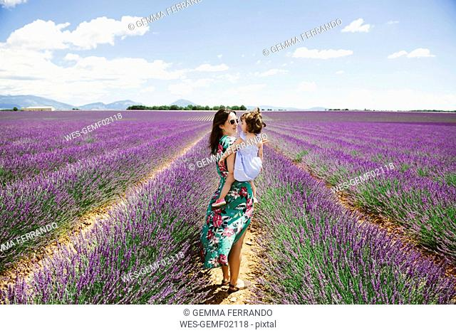 France, Provence, Valensole plateau, Mother and daughter in lavender fields in the summer