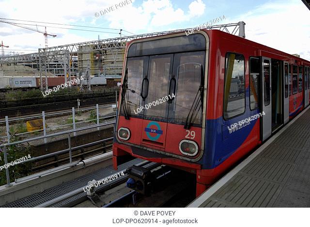 England, London, Stratford, A Docklands Light Railway train by a platform at Stratford station. The Docklands Light Railway will form part of the transport...
