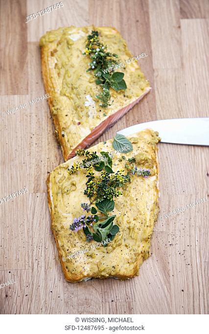Grilled Ikarimi salmon with a mustard and honey glaze, on a cedar board