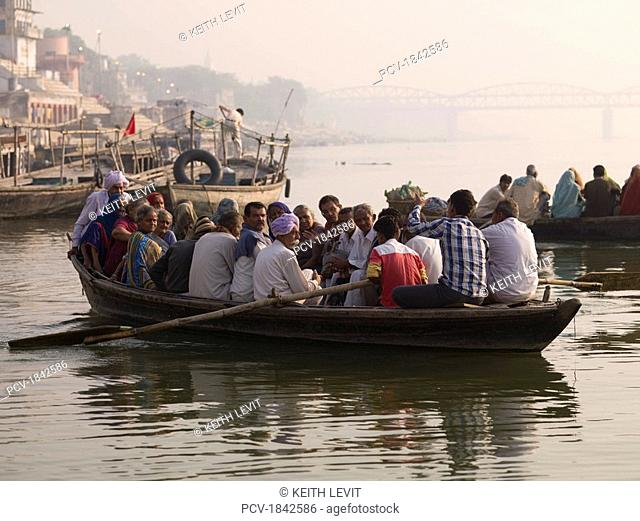 Varanasi,India,People on a boat for transport down the Ganges River