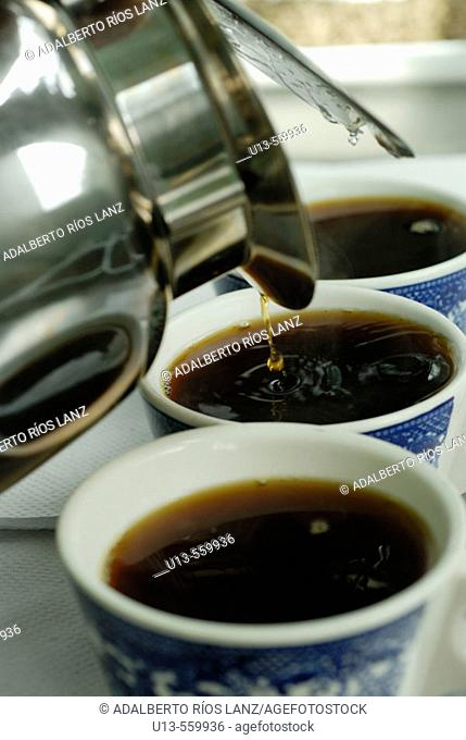 Three Cofee Cups Being Served