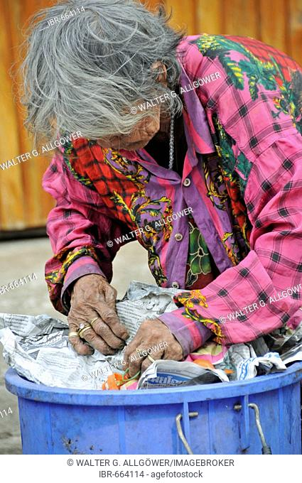 Old-age poverty: woman sorting through trash in Sukhothai, Thailand, Southeast Asia, Asia