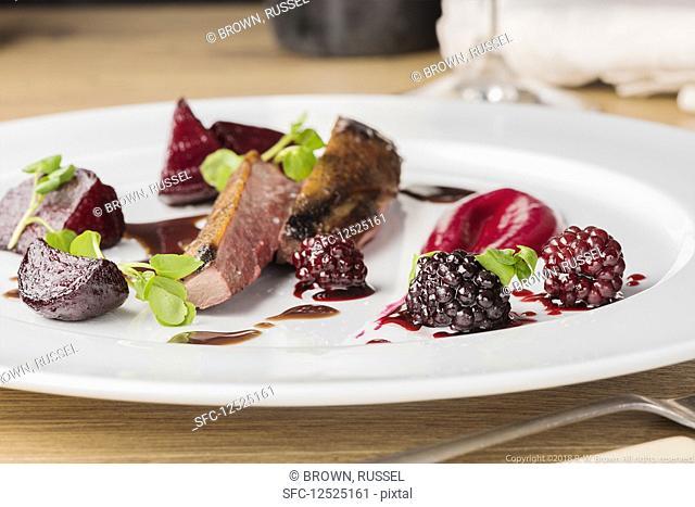 Wild duck with blackberries and beetroot