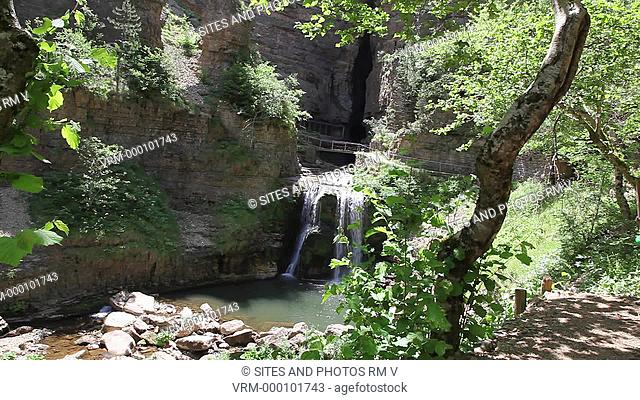 LS. Daylight. Entrance to the cave, through a bridge above a waterfall. The Bonheur Happiness River has its spring near the observatory Mont Aigoual at the...