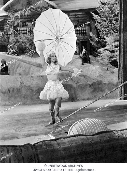 United States: c. 1933.A young woman performer prepares to walk a tightrope