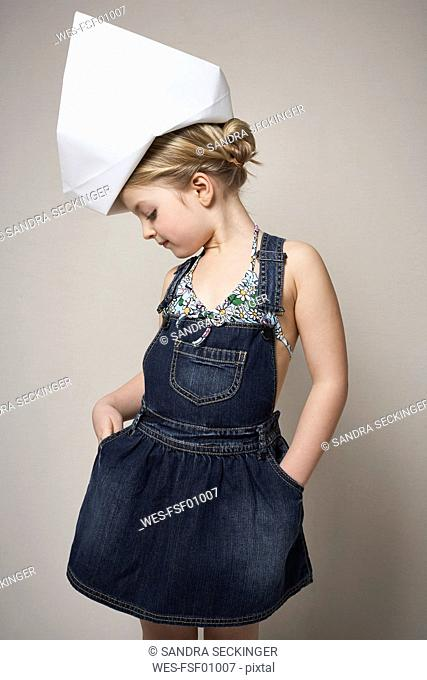 Fashionable little girl wearing big paper hat