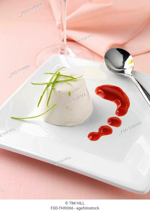 Lime and coconut panna cotta with raspberry coulis