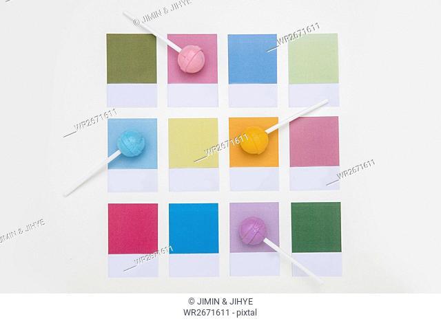 Various lollipop candies on various color codes