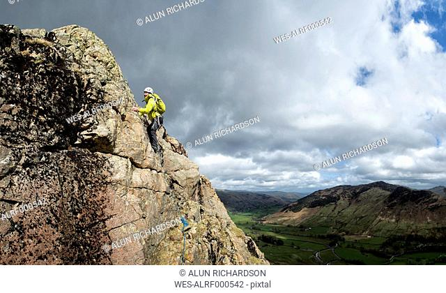 England, Cumbria, Lake District, Langdale, Raven Crag, Middlefell Buttress, climber