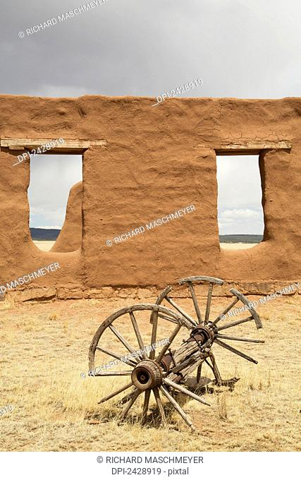 Old wagon wheels with remnants of Fort Union at Fort Union National Monument; New Mexico, United States of America