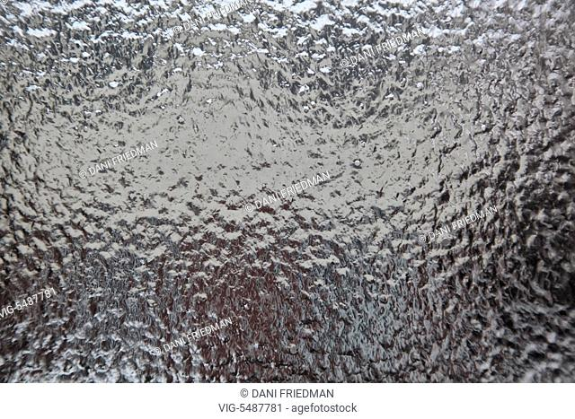Ice covered window pane after an ice storm in Toronto, Ontario, Canada. - TORONTO, ONTARIO, CANADA, 24/03/2016