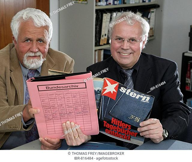 Archivists Klaus Oldenhage, left, and Josef Henke of the Federal Archive of Germany in Koblenz, pictured with an edition of Stern Magazine about the alleged...