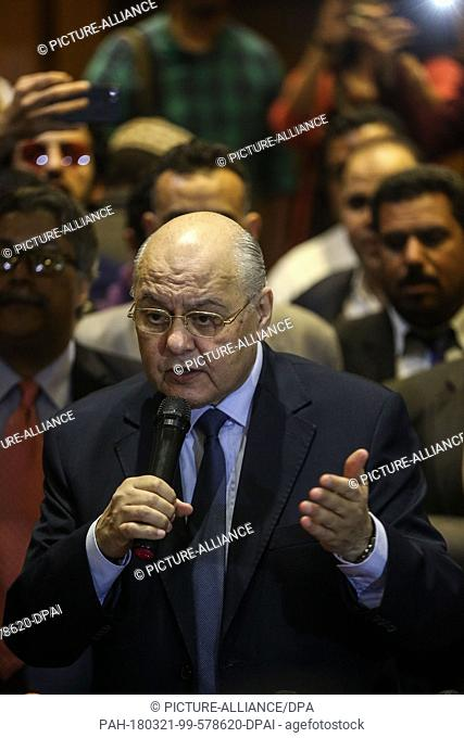 Egyptian Presidential candidate and leader of El-Ghad Party Moussa Mostafa Moussa (C) speaks during a press conference at the party's headquarters in Cairo