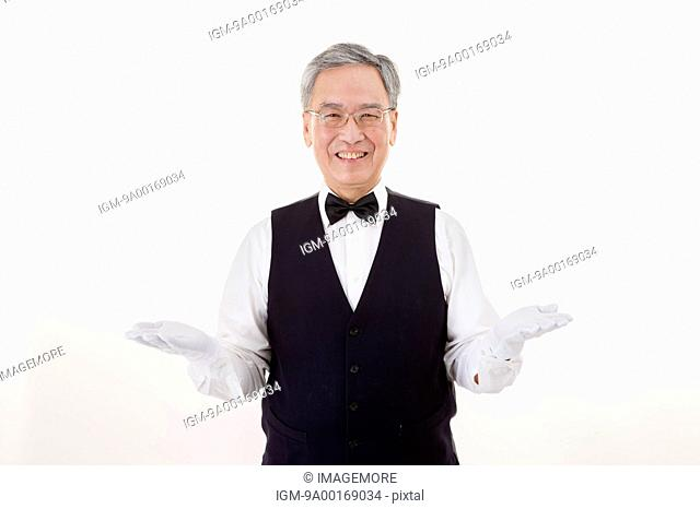 Businessman smiling at the camera and gesturing