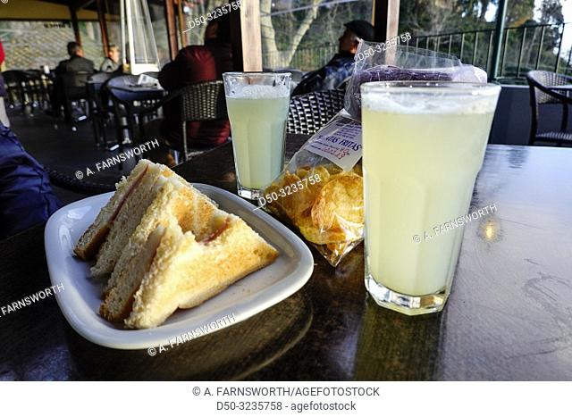 Funchal, Madeira, Portugal Lemonade and grilled cheese sandwich known as a tosta mista and chips at a cafe